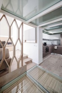 A dividing wall is used to separate rooms in this ...