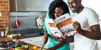 Woman cooking with Jamaican man in the kitchen togethe