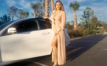 the life of a model interview with ilka tamar standing by a luxury car in a pair of lace up heels and wrap maxi dress