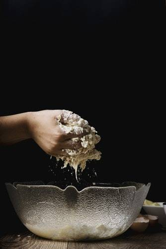 hand mixing the dough