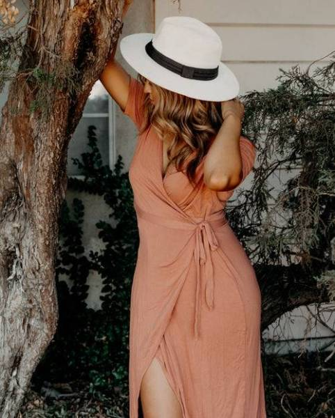woman in wrap dress and white hat, black trim How to Date Casually Without Hurting Anyone