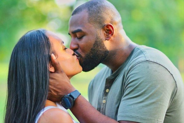 Loving Ways to Support Your Partner Building Their Career black couple kissing