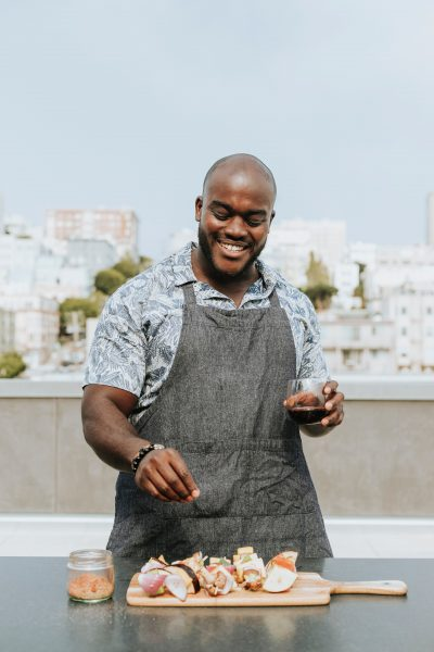 Happy Weight: The New Relationship Weight Gain - man cooking on rooftop wearing apron