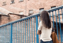 Prison Dating: How to Tell if He's Manipulative prison dating woman walking up to prison gates
