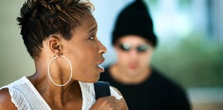 man with black cap and dark glasses following pretty black woman How to Handle a Psycho Ex Boyfriend