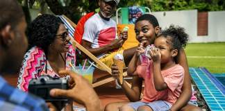 black family enjoying summer together at backyard exceptMy Child Doesn't Like My New Partner