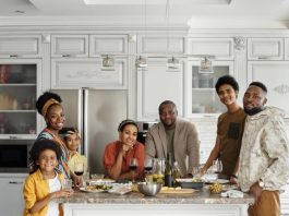 dating a man with kids will make this blended family in the kitchen having dinner closerPhoto by August de Richelieu from Pexels