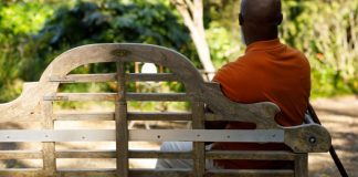 dating is harder man sitting on bench by himself