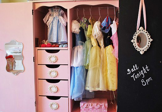 Vintage armoire repurposed to hold dress up and doll clothes | 11 Magnolia Lane
