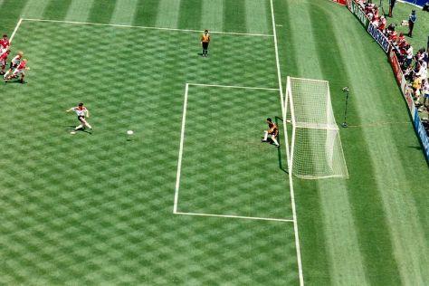 Matthäus scores a penalty kick against Bulgarian goalkeeper Borislav Mihaylov in the 1994 World Cup quarter-final