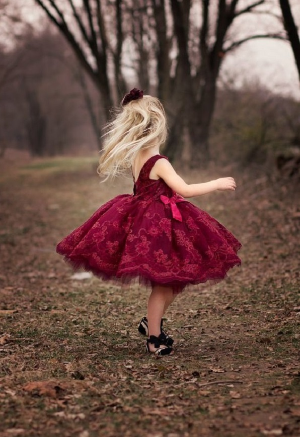 Flower girls in burgundy colored dress with golden tiara