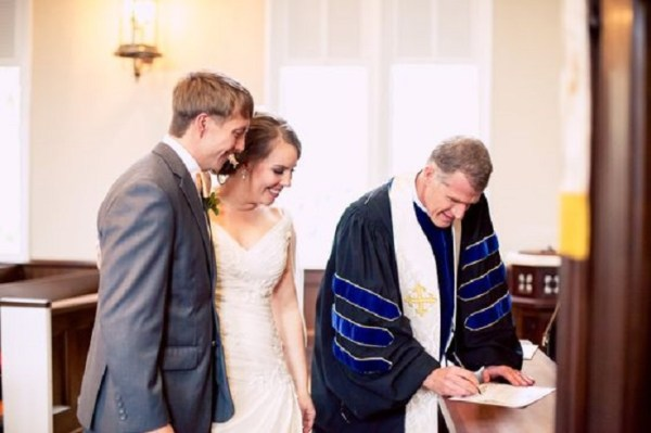 Officer signing a Marriage Certificate - 123WeddingCards