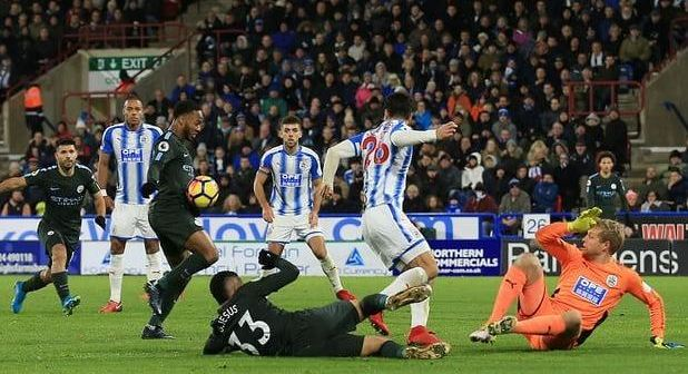Pep-Guardiola-hailed-Man-City-2-1-win-over-Huddersfiled