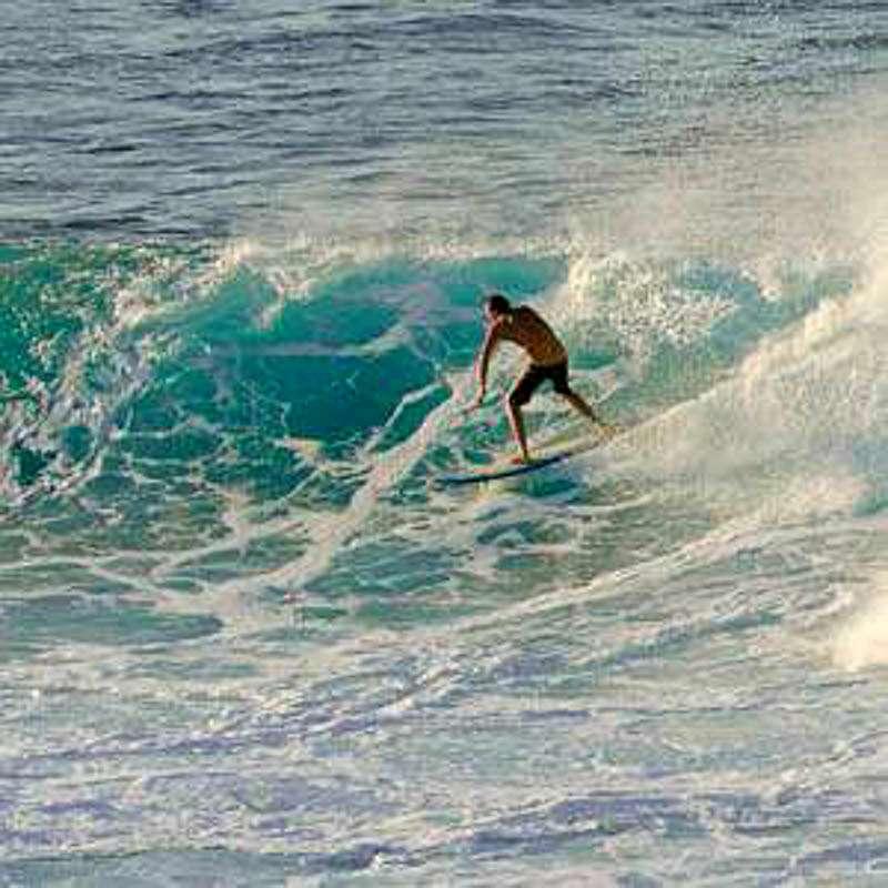 photo of surfer on Maui, HI