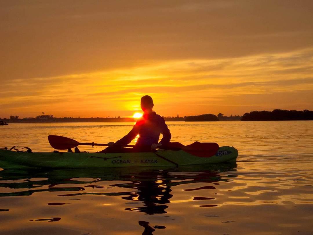 Kayaker at sunset on Sarasota Bay