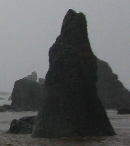 Photo of rock in fog off the coast
