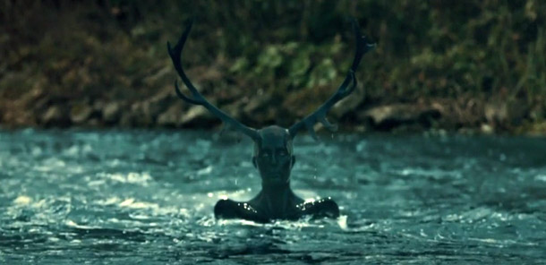 """Fig. 11: The """"stagman"""" and the raved-feathered stag are two nightmarish images about hunting that keep appearing in the show. Here Will is imagining fishing in a stream when he is interrupted by the stagman, symbolizing Lecter."""