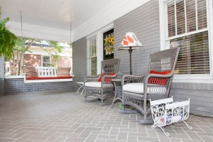 Updating the porch's tile floor with brick pavers in a more modern herringbone pattern was among the couple's earlier home-improvement projects.