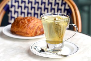 A flaky croissant and cup of tea are a luscious, light breakfast or afternoon snack.