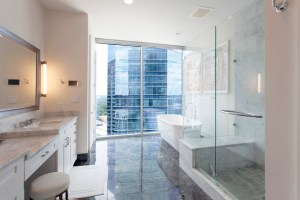 Motorized window blinds provide privacy throughout the condo, including the master bathroom.