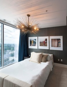 A new light fixture from R Hughes adds ambient lighting to the guest bedroom.