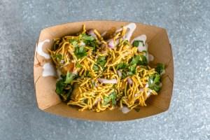 SPDP, please! The popular dish combines potato-stuffed puris, crunchy noodles, yogurt and tangy chutneys.