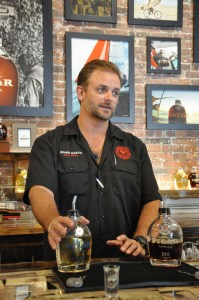 Hemingway Rum Company's Shawn Martin offers visitors a taste.