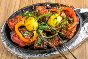 The mixed tandoori platter includes chicken tikka, paneer tandoori, lamb boti kabab and salmon and shrimp tandoori.