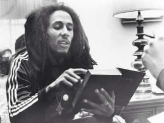 Bob Marley reading the bible