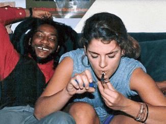 Rasta and white woman smoking marijuana