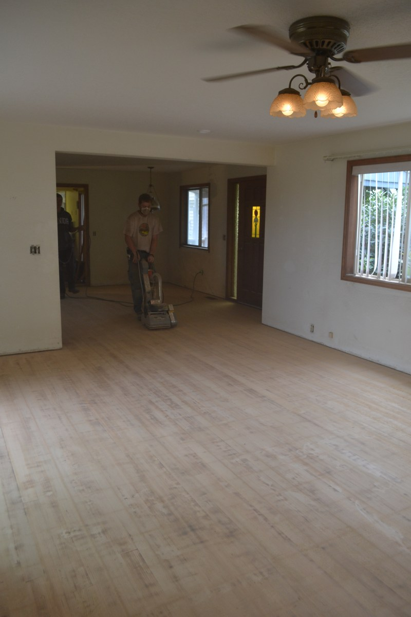 How to Refinish Hardwood Floors After Removing Laminate Tiles