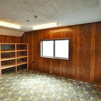 Hello 1970s wood paneling! How we removed the paneling and hung drywall to transform this bedroom