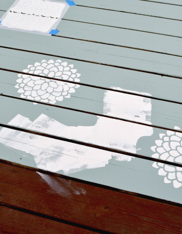 Toddler addition to painted outdoor rug