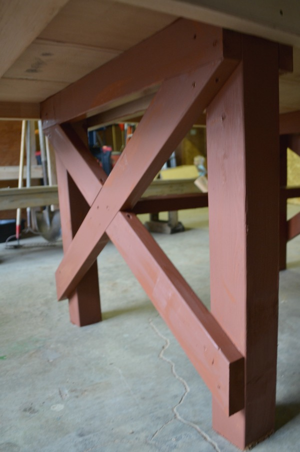Outdoor table legs painted with redwood stain