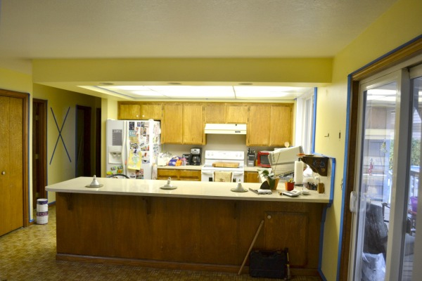 Outdated kitchen cabinets before paint