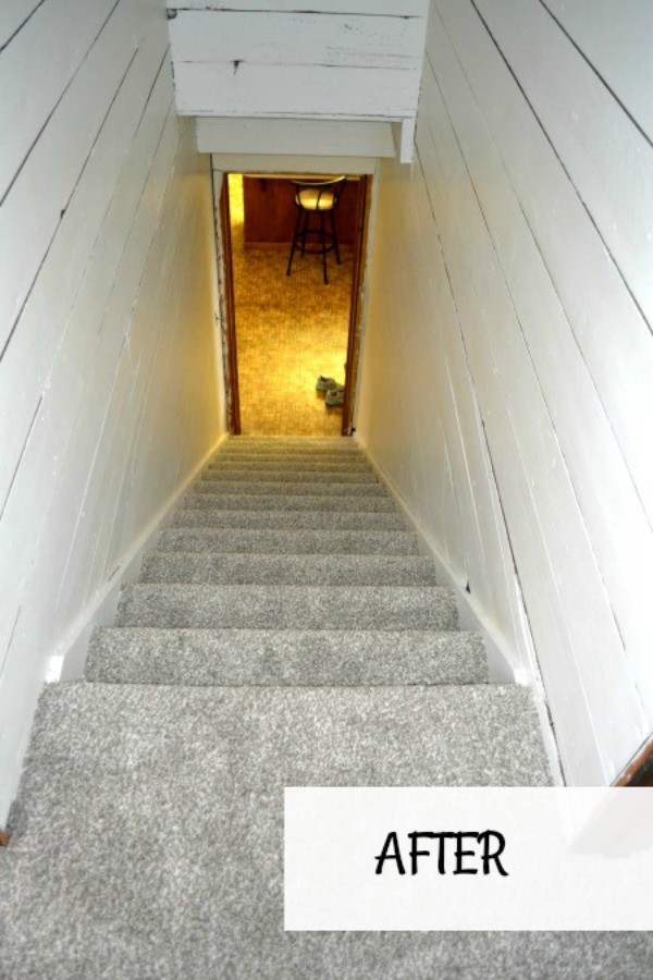 After we removed wood paneling and wallpaper and painted our stairwell to update and lighten the space