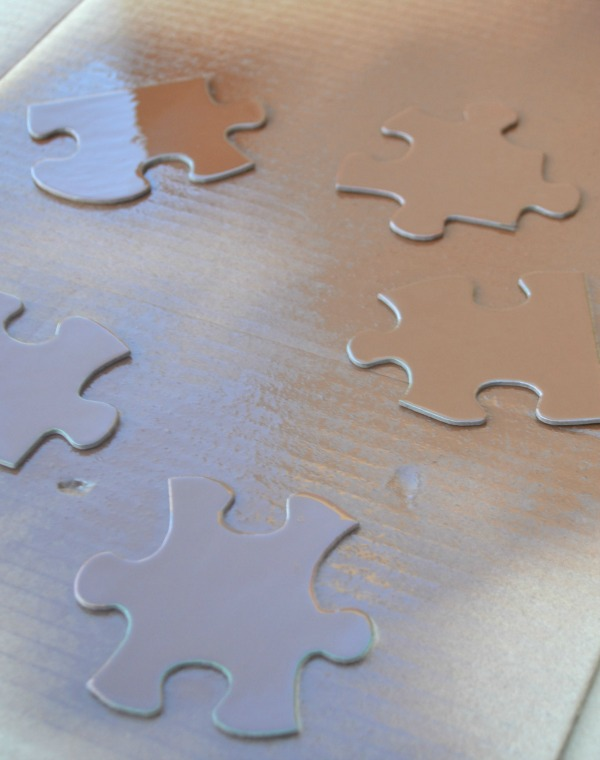 Spray paint puzzle pieces to make an easy and fun Christmas DIY