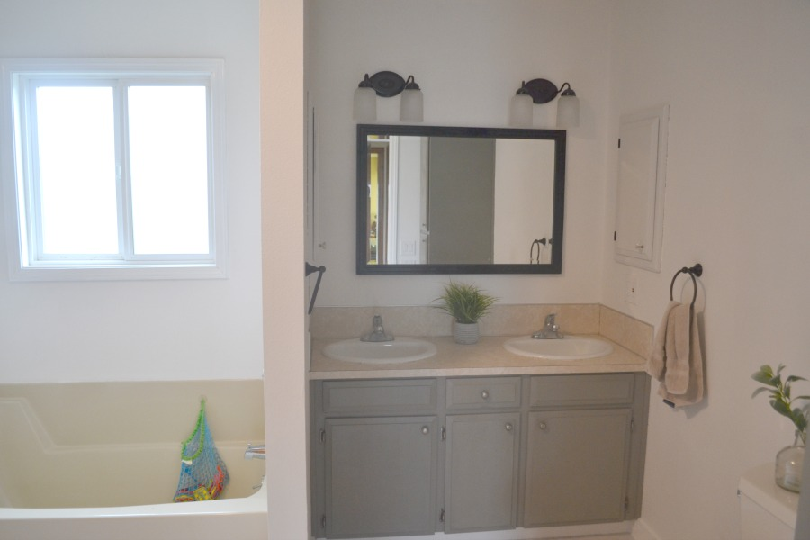 Vanity space after painting cabinets with chalk paint, adding a new mirror and updating the lights