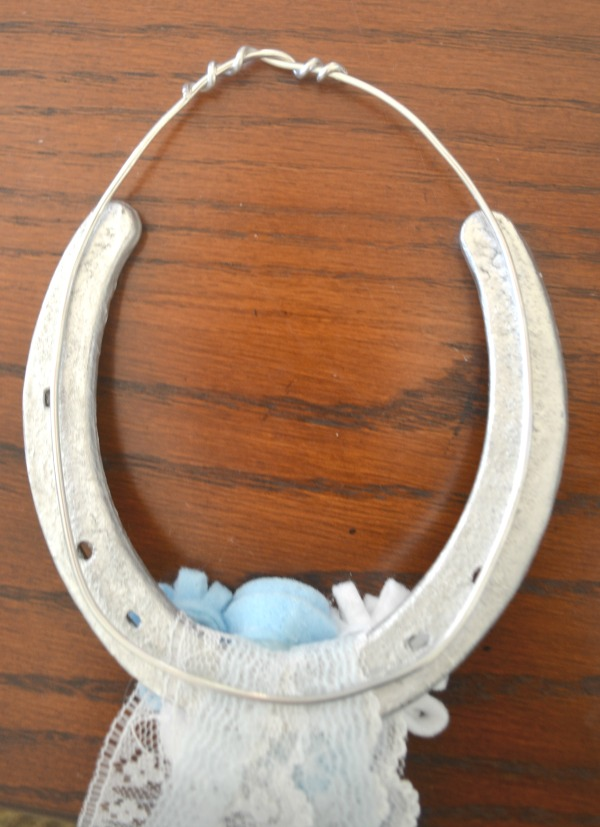 Heavy gauge wire is used to hang the horseshoes