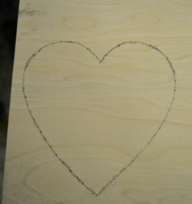 Heart traced onto thin scrap wood for the coaster