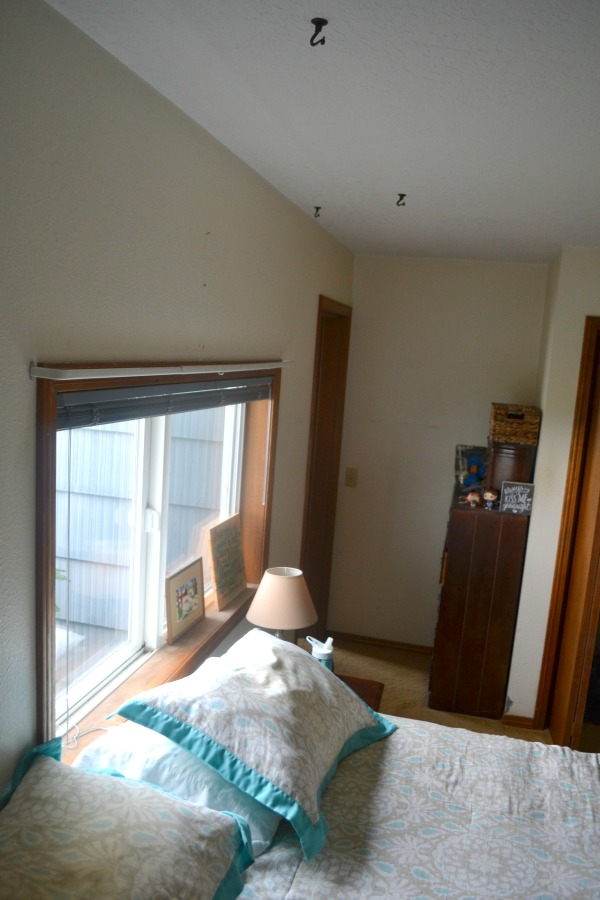 Outdated and small master bedroom with one window