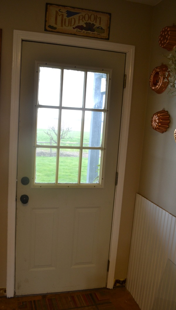 Laundry room door before with a pale gray color but otherwise in good condition
