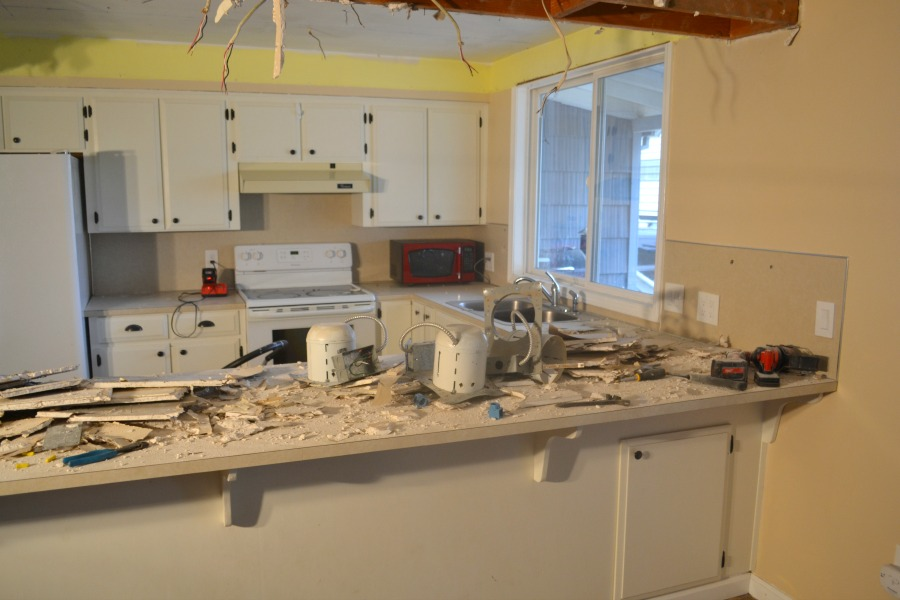 A countertop covered in drywall debris and dust