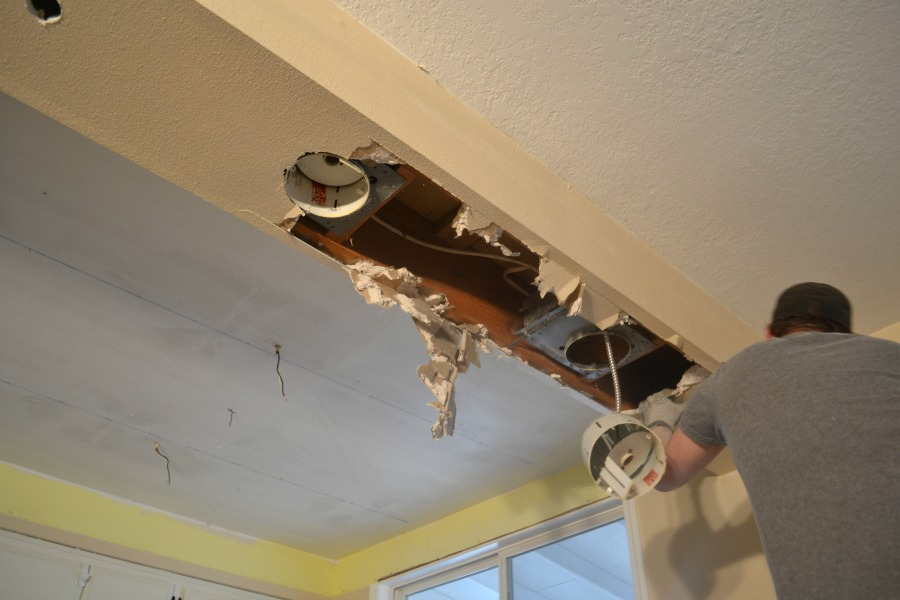 Viewing up toward the drop ceiling with some drywall removed