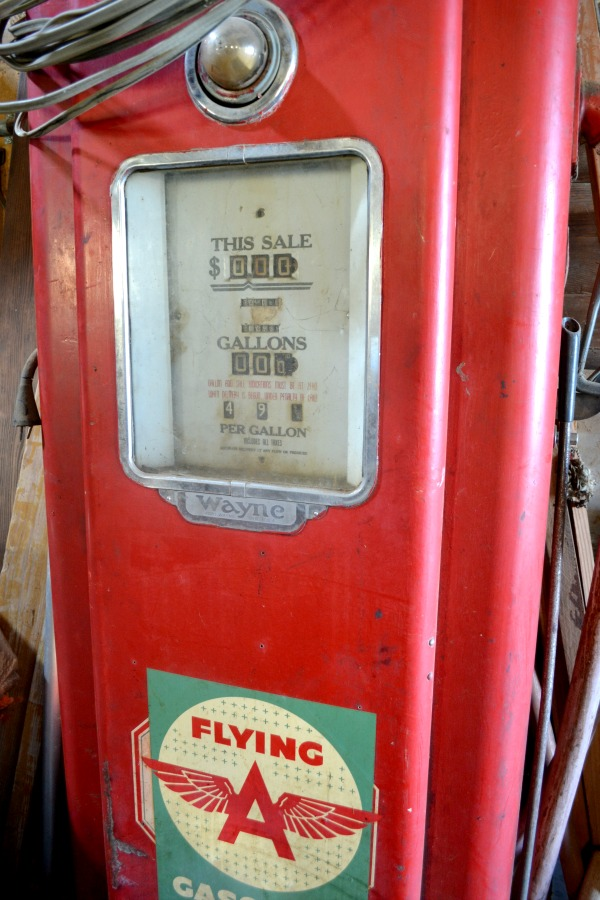 A red vintage Flying A gas tank