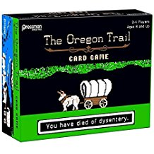 An angled view of a black game box entitled The Oregon Trail card game