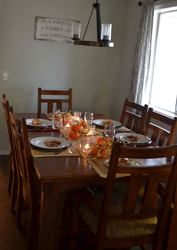 A wide angle of a dining room with six place settings