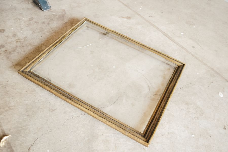 A wood frame laying on a concrete floor