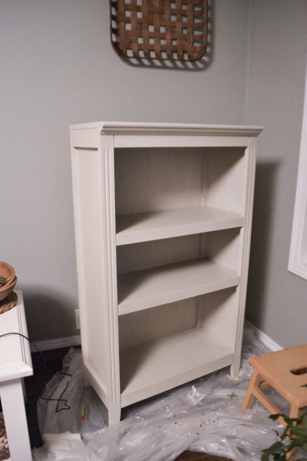 A close up of an empty bookshelf completely white