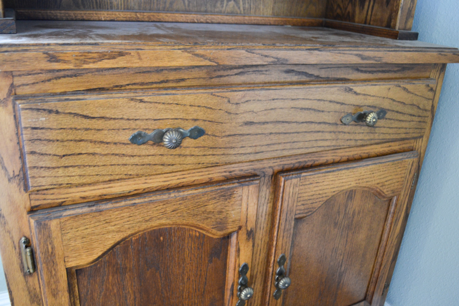A close up of a drawer in a hutch